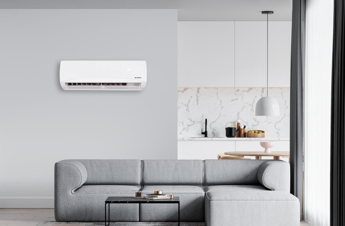 Moderno salón con aire acondicionado split de Aspes AAS1240.